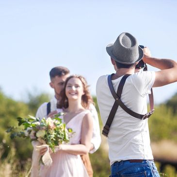 Wedding guests with Photographer in Eagle Bay, Girl is holding flowers and looking at photographer