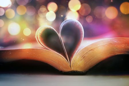 open book with pages folded in shape of heart