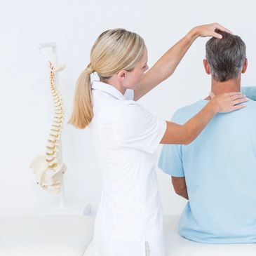 Female chiropractor is performing a chiropractic adjustment on a male patient.