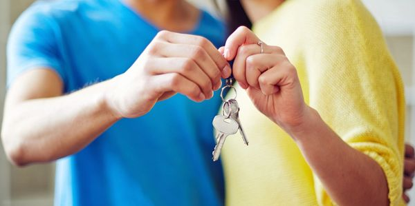 Happy couple receiving their keys to their new home