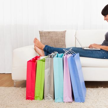 Picture of woman shopping online. Ecommerce options are critical in the digital conversion process