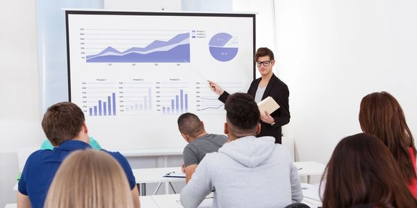 Woman giving a sales presentation using graphs.