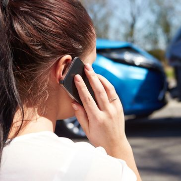 woman in car accident on phone in Tomball The Woodlands Texas
