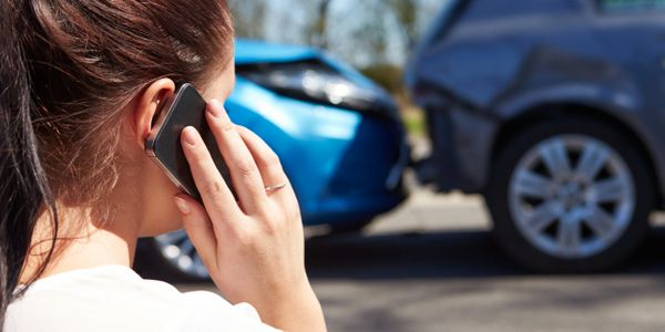 a woman calling her lawyer after being in a car accident.