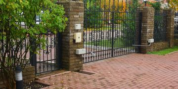 Fenced entrance with shrubs