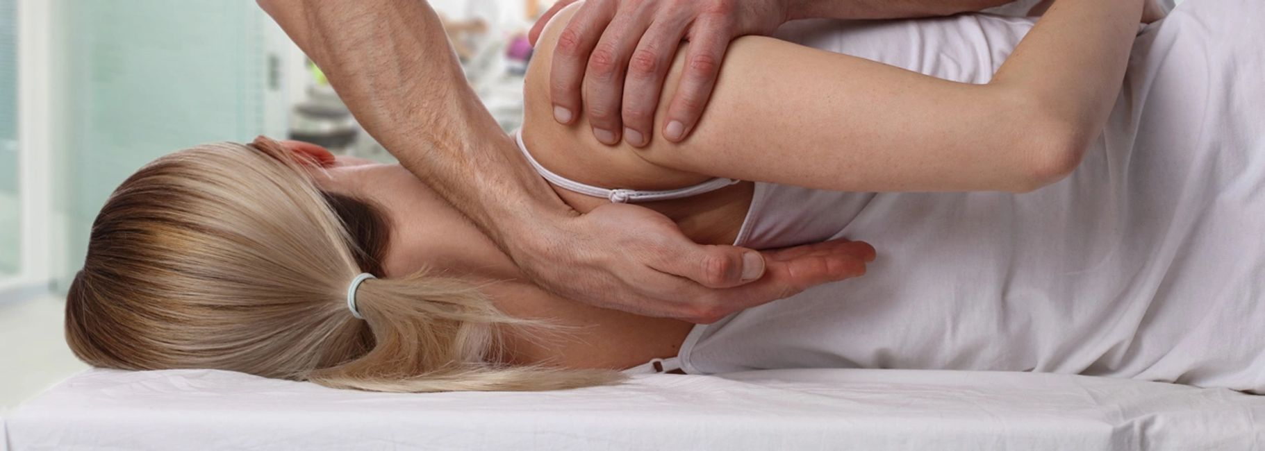 Woman Receiving Chiropractic Treatment