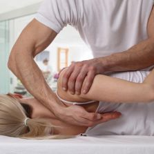 Chiropractor applying back pain treatment