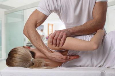 Woman receiving chiropractic back pain service