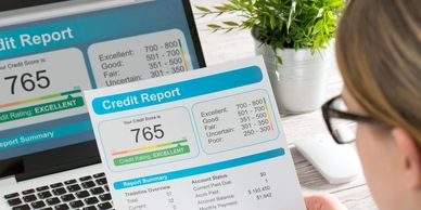 client reviewing credit report after our consulting, marketing, and advertisement help.