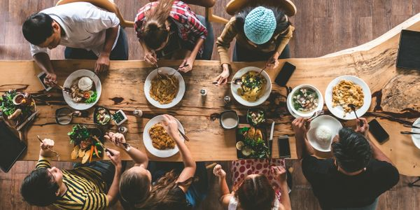 Diverse people within the community sharing a meal.