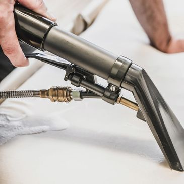 Upholstery tool demonstrating upholstery cleaning