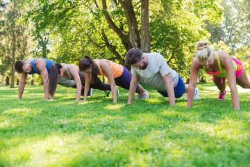 Small group exercising outdoors