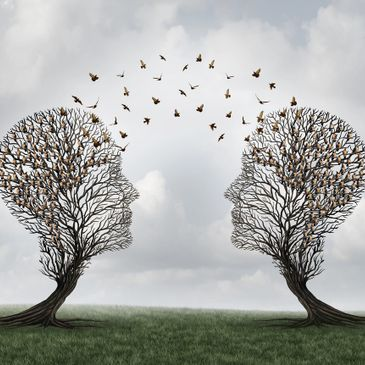 Two tree images in the abstract shape of human heads with birds, representing ideas, flying between them.  This is abstract art and very beautiful.