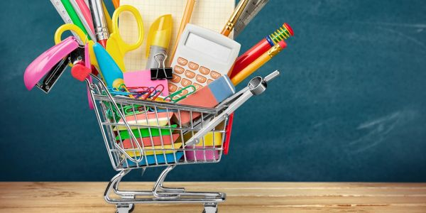 Mini shopping cart filled with office supplies