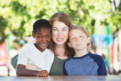 Interracial family with mother and 2 sons representing eligibility requirements for Uganda adoption