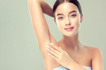 Model holding her hairless underarms