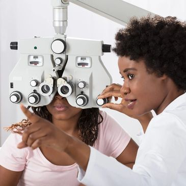 Female optometrist conducting an eye exam for a patient