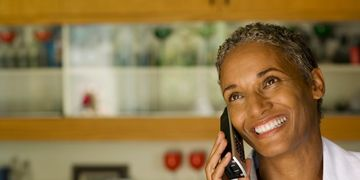 smiling african-american woman on the phone