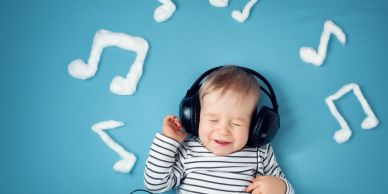 Picture of a baby with earphones.