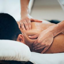 A person receiving a deep tissue massage.