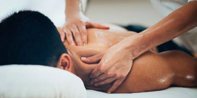 Man receiving therapeutic massage and myofascial bodywork.