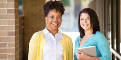 Two Ladies who are going to school (One black and one white).  Education Management systems