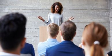 Woman teaching as corporate speaker