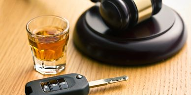 image of a judge mallet, alcohol in shot glass and car keys