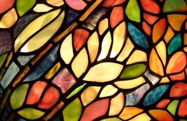 Stained-glass of leaves and flower petals.