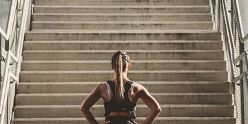 Fit athlete running up stairs