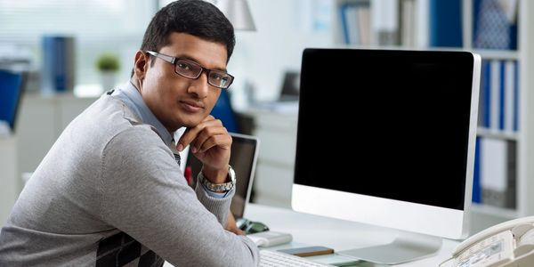 Account representative sitting in front of computer