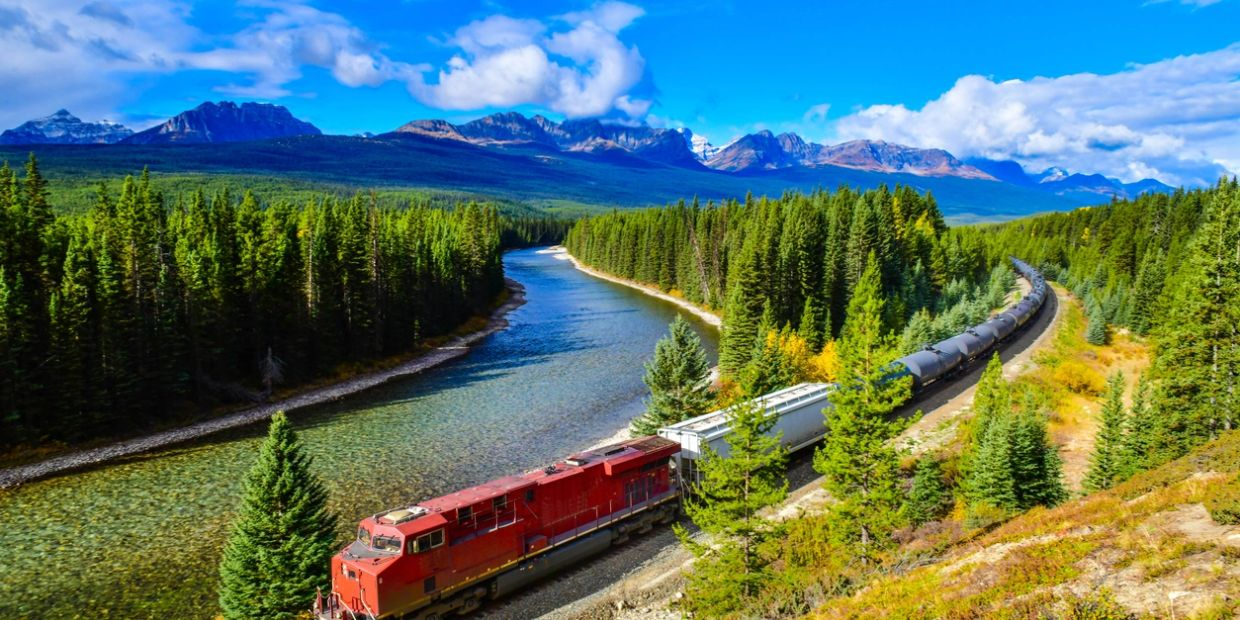 Alberta Scenery showing an industrial train travelling through the Rocky Mountain