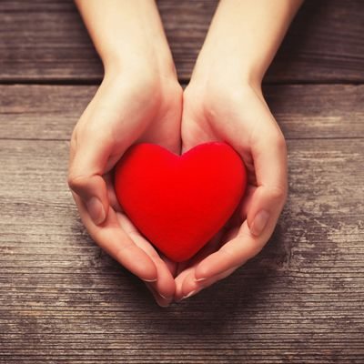 We love our clients! Picture of hands holding a heart