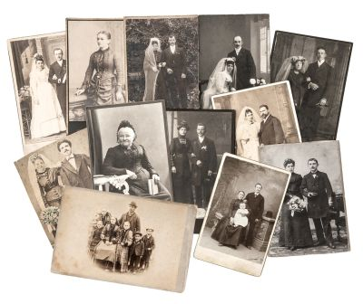 A grouping of old time photographs displayed on the table