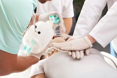 CPR in progress with bag valve mask