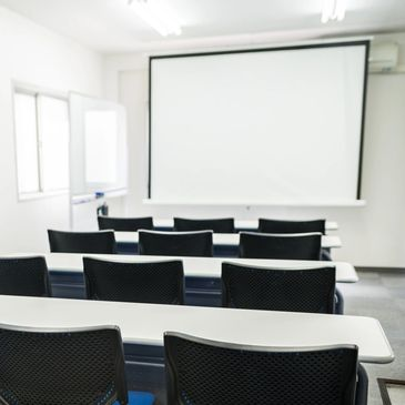 Lecture theatre with chairs facing board