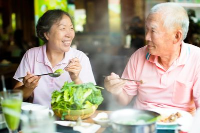 Adults enjoying healthy food and our nutritional suplements part of a  scientific nutrition plan.
