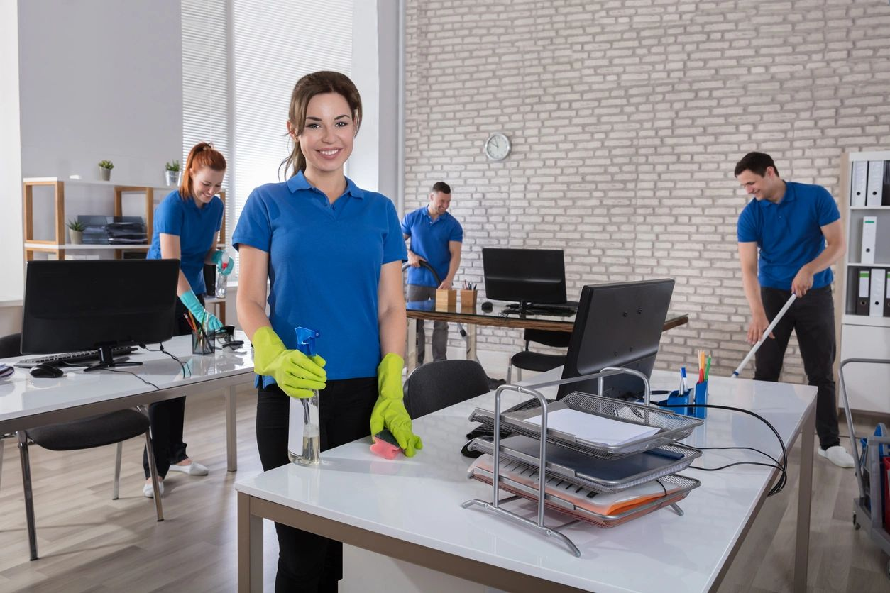 Team of people cleaning an office