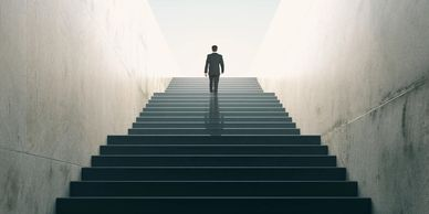 Man climbing the leadership success staircase.