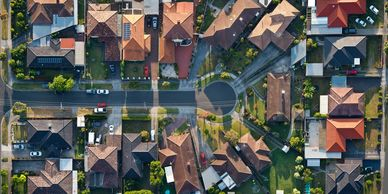 Aerial shot of a cul-de-sac in a suburb on sunny day