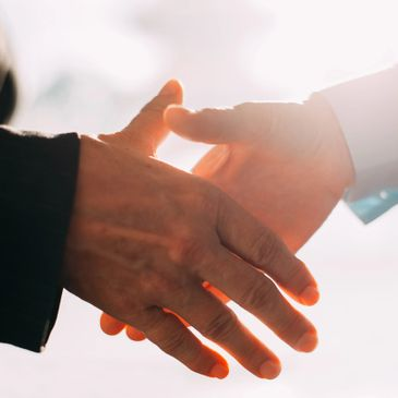 Two people shaking hands in agreement.