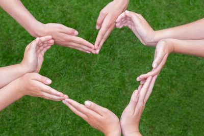 Hands form the shape of a heart