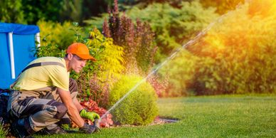 Worker maintaining irrigation system