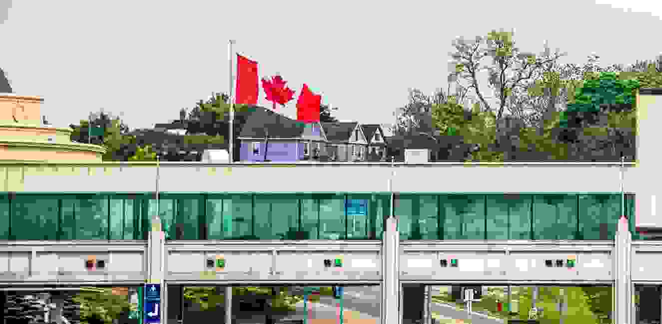 Canadian flag fluttering on a building Study in Canada page