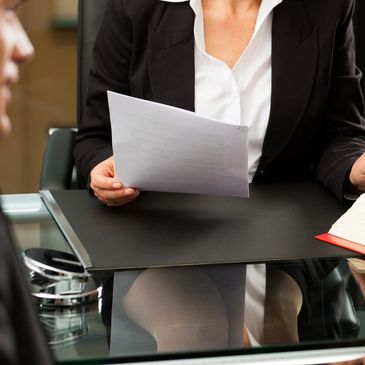 Woman looking a Staffing Solutions document
