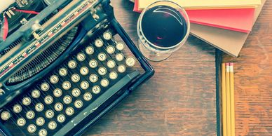 type writer and a glass of wine