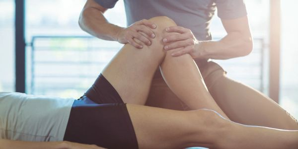 therapeutic massage working on the knee