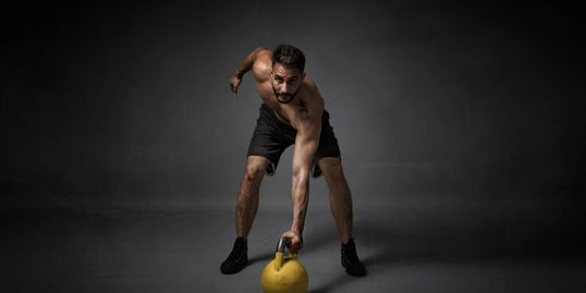 Man working out with kettle ball