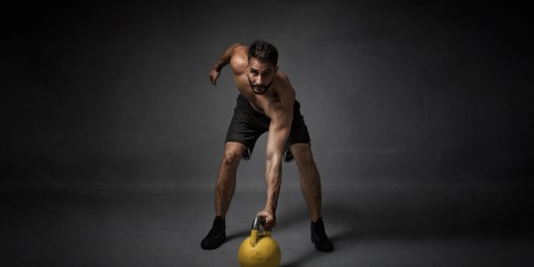 man lifting kettlebell