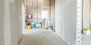 commercial drywall installation with sheetrock taped and mudded